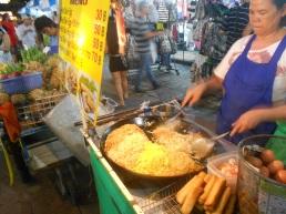 Bangcoc - A mão que pega a comida e o dinheiro